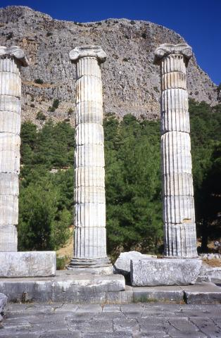 Ancient columns with a cliff behind theme