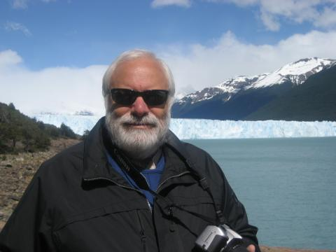 Leftheris with his camera, glacier and lake in the background
